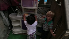 Exploring the toy kitchen